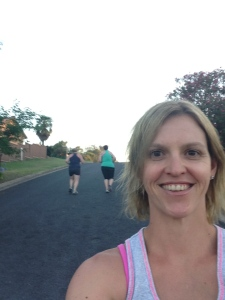 Kim taking a selfie and still managed to capture us running up the hill.  That's skill!